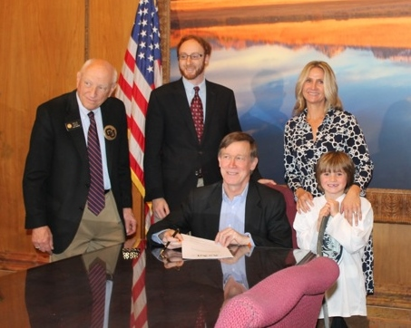 Senator Rollie Heath, Michelle Peterson, Representative Johnathan Singer and Governor Hickenlooper during the signing of Colorado Bill SB 13-012.